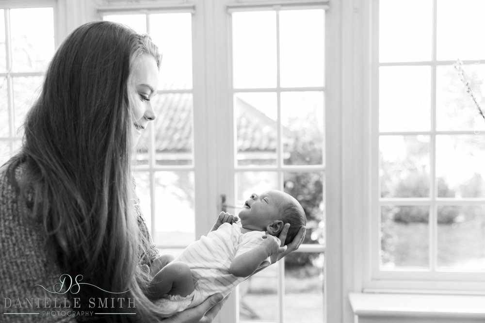 big sister holding baby brother - newborn photography brentwood