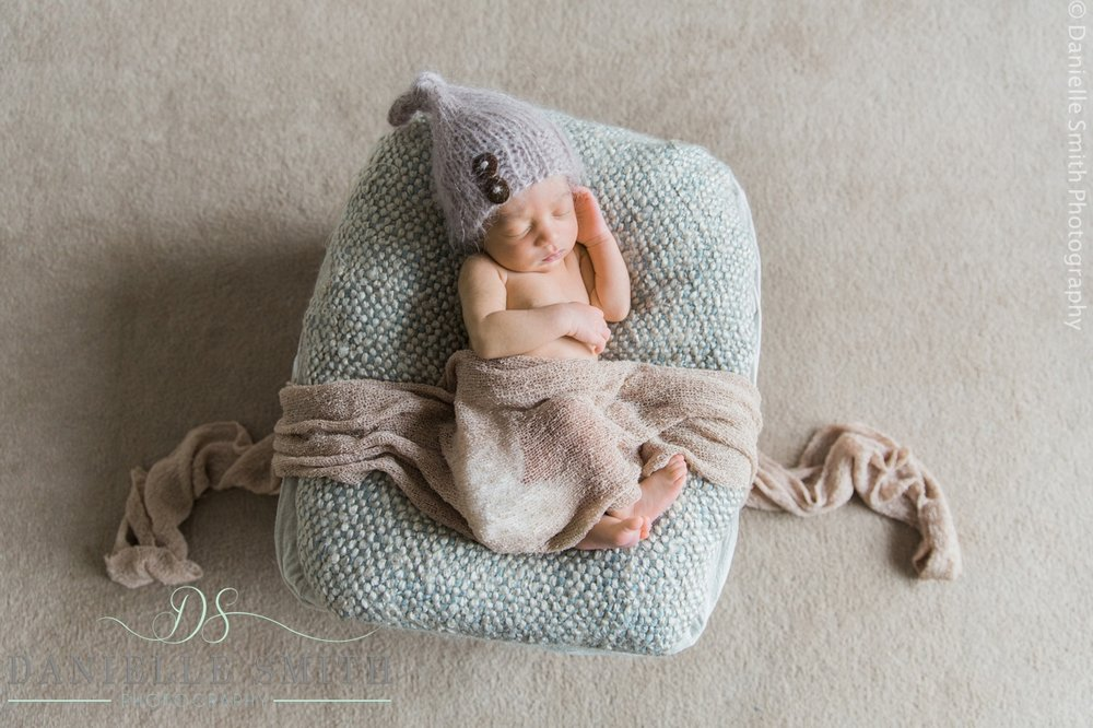 baby asleep in basket from overhead