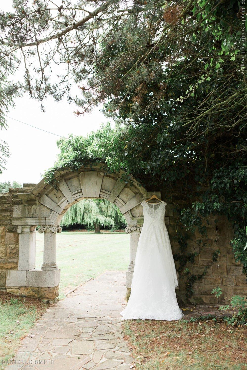 wedding dress hanging up outside