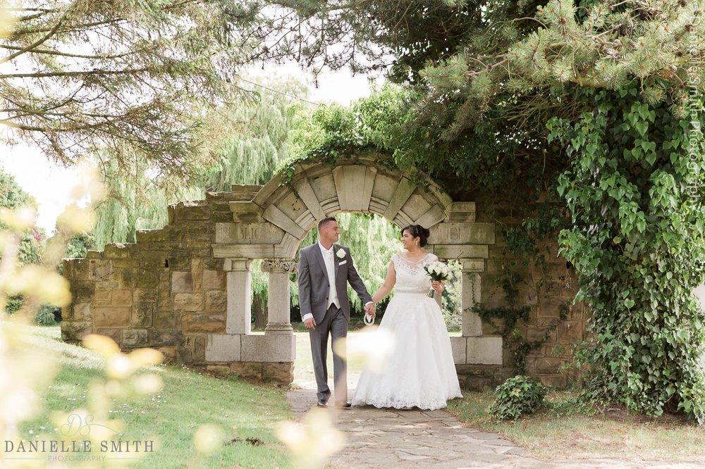 bride and groom walking  at ye olde plough house wedding