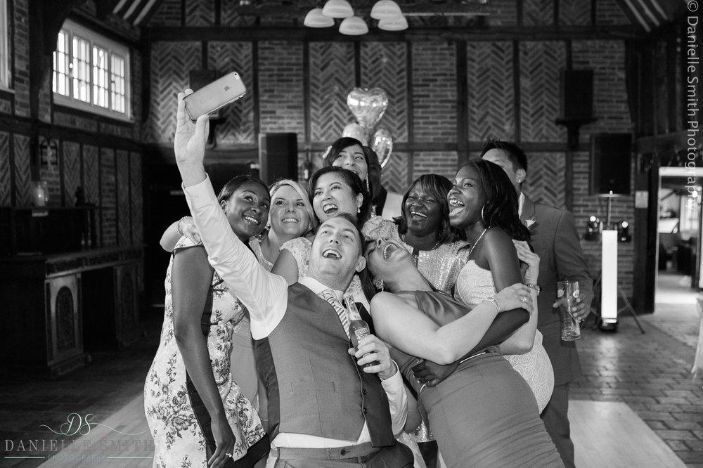 wedding party having selfie on dancefloor