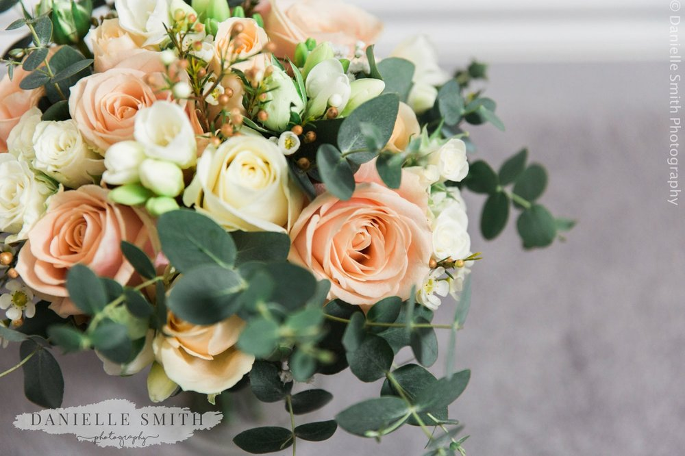 peach and ivory roses in wedding bouquet - informal wedding at home