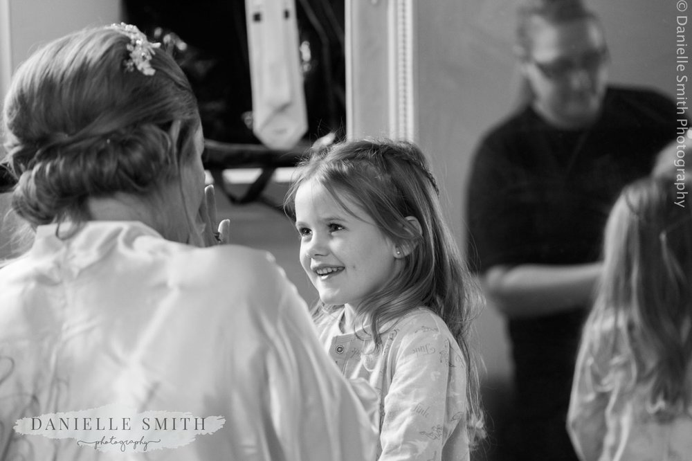 flower girl and mum getting ready