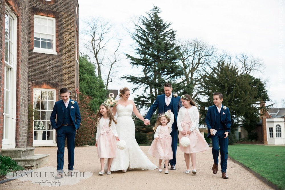 bride and groom and their children outside langtons house wedding