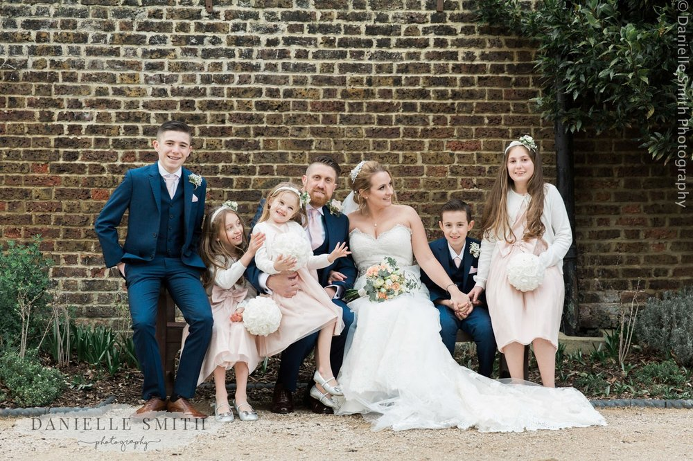 bridal party sitting on bench - informal wedding at home