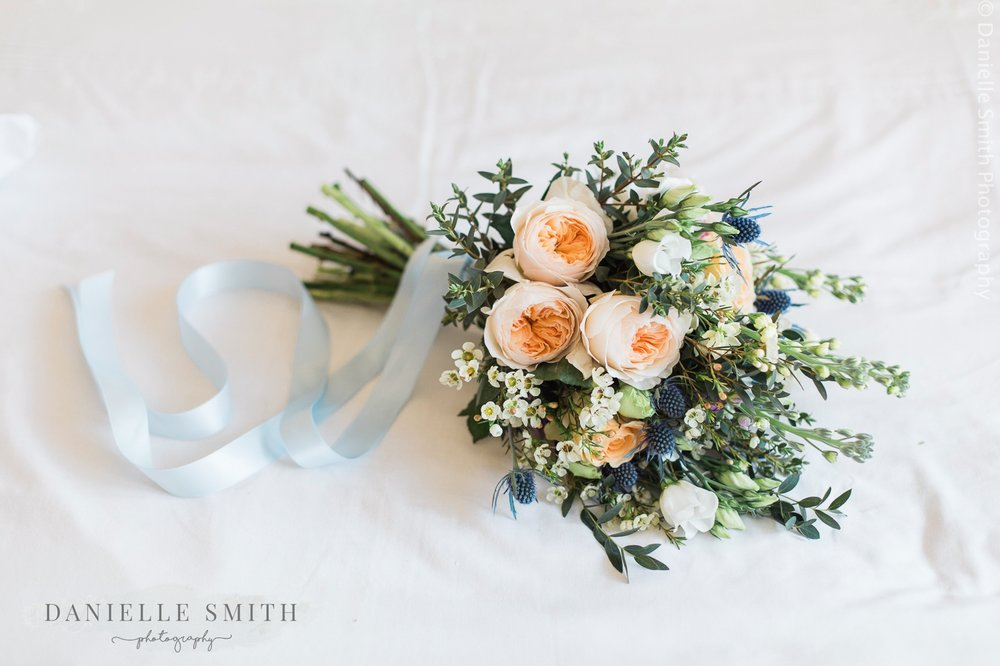 pastel coloured wedding bouquet with ribbon