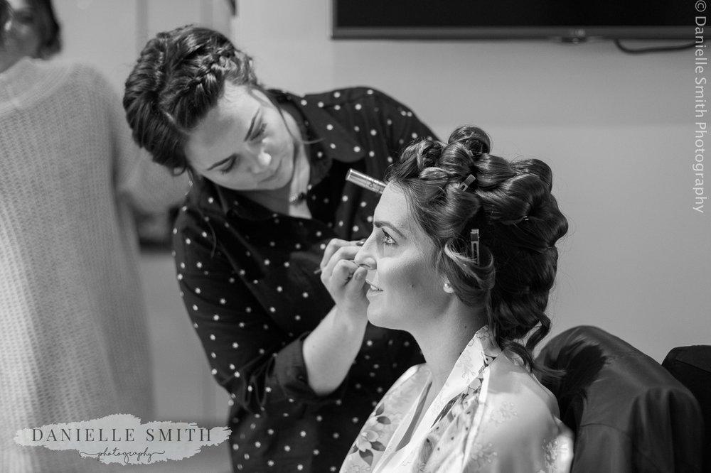 bride having her make up done - ingatestone hall wedding