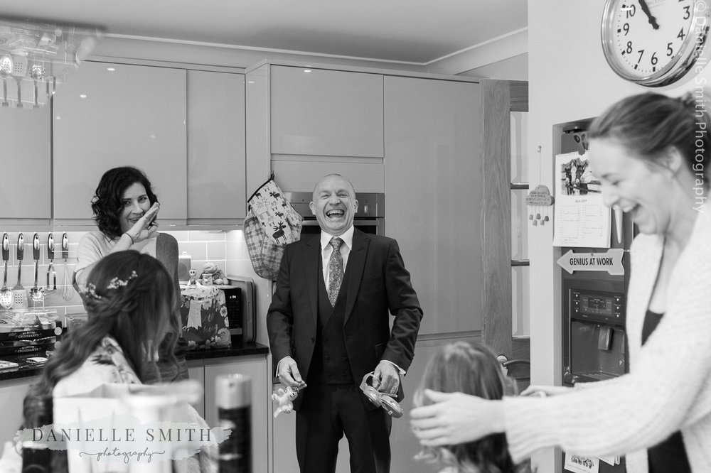 dad laughing during bridal preparations