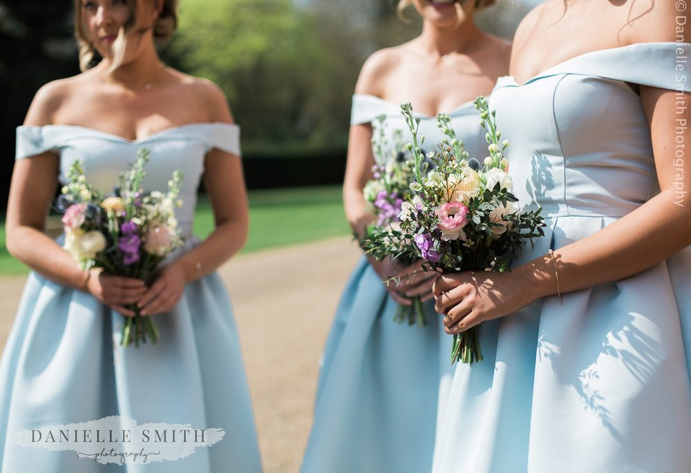 pale blue bridesmaid dresses and pastel flowers