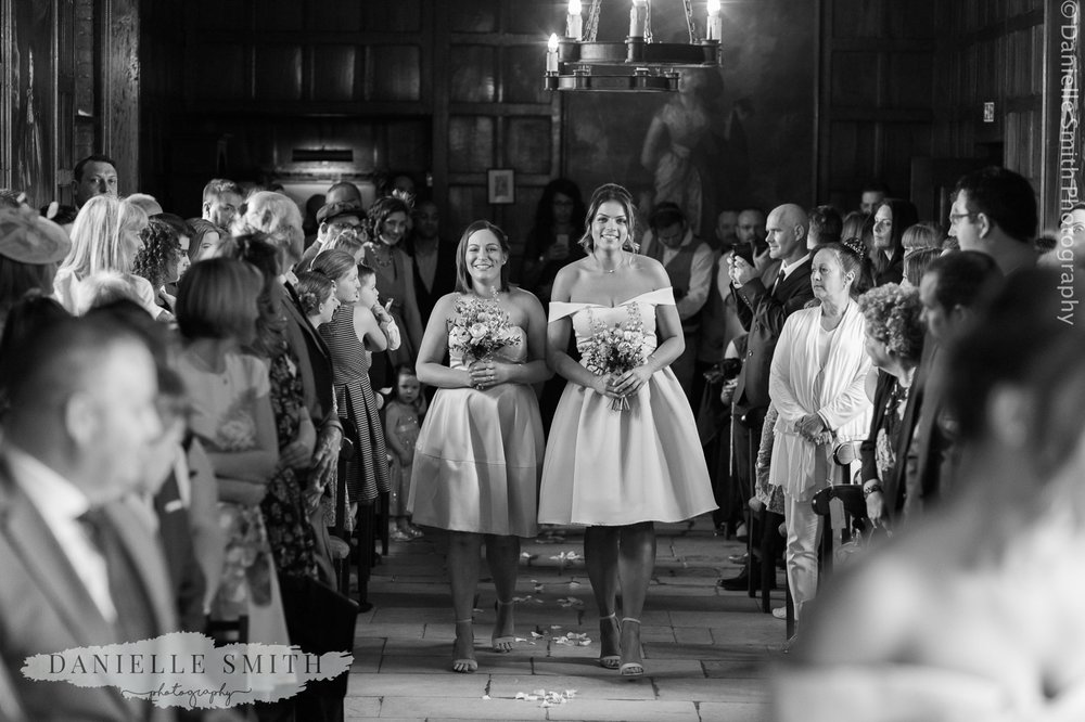 bridesmaids walking down the aisle at ingatestone hall