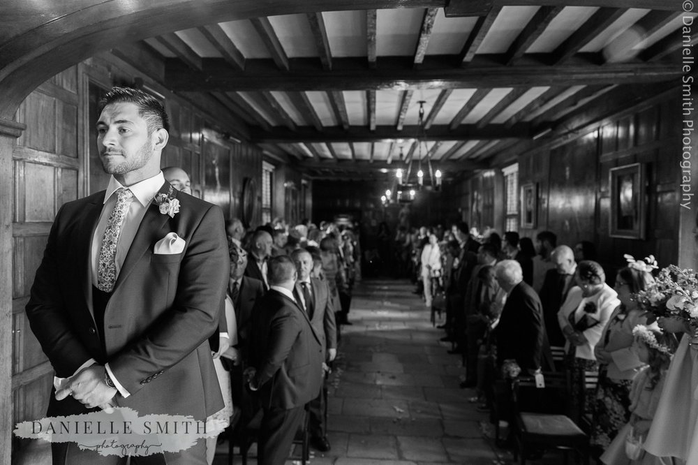 groom waiting for the bride to walk down aisle