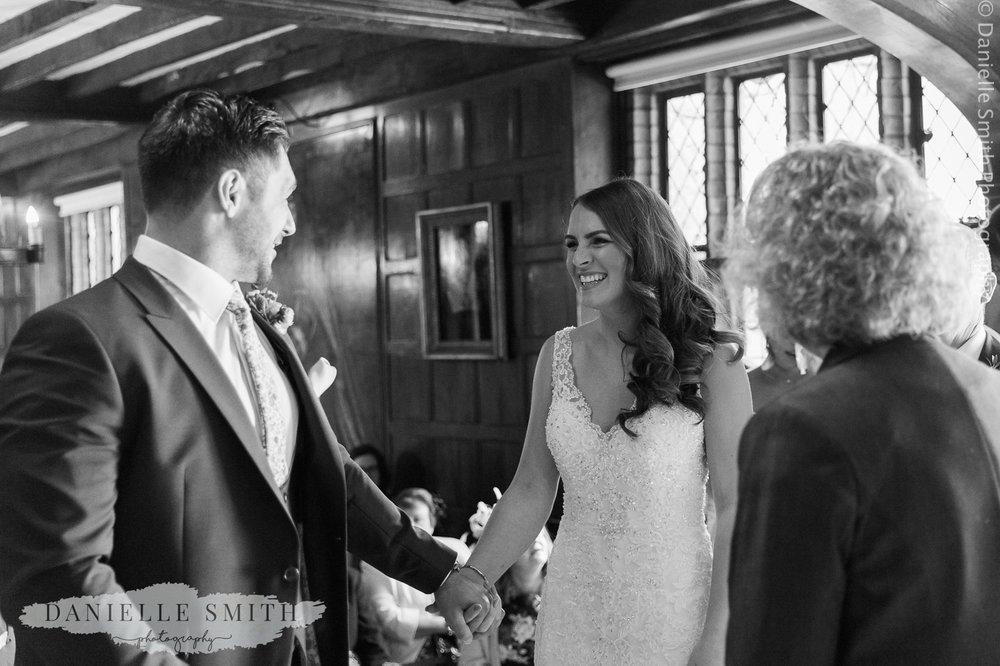 bride and groom smiling - ingatestone hall wedding