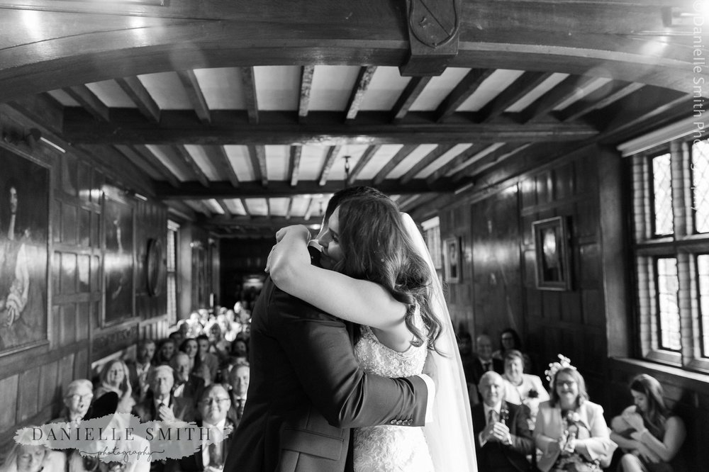 bride and groom hugging after married