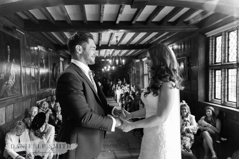 bride and groom tying the knot - ingatestone hall wedding