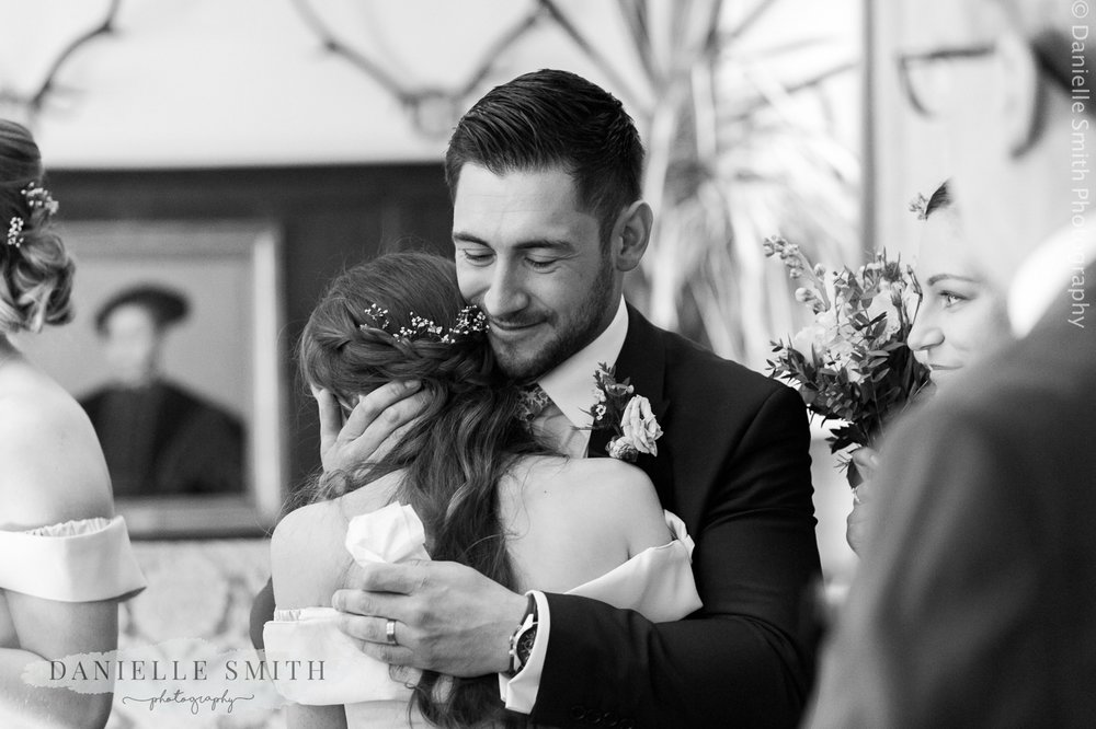groom hugging his niece
