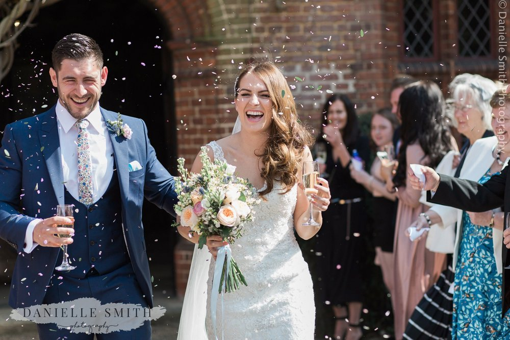 bride and groom confetti photo - pastel coloured wedding