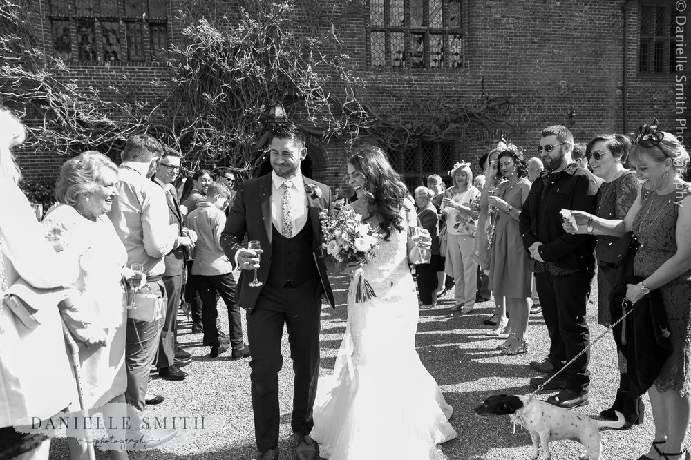 bride and groom laughing during confetti