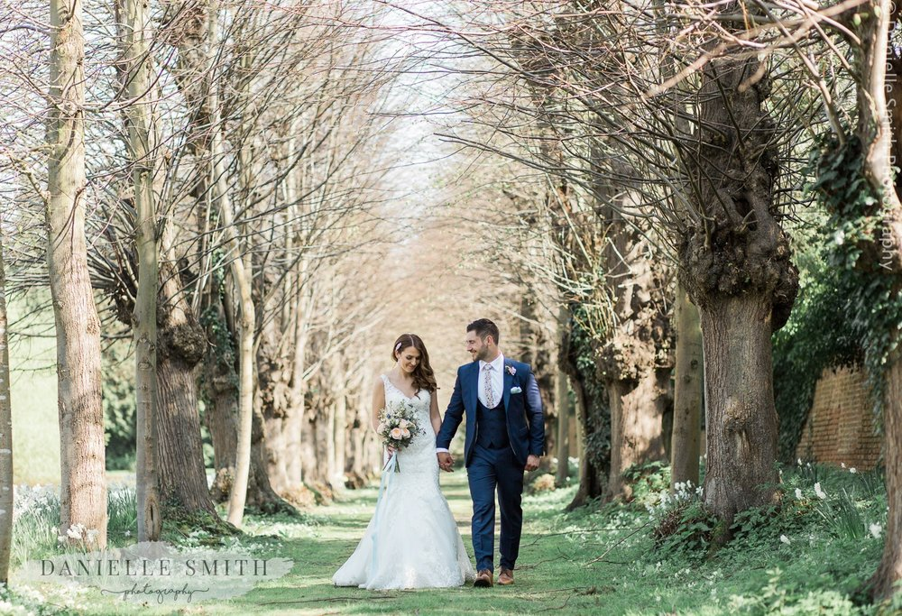 bride and groom portrait at ingatestone hall grounds