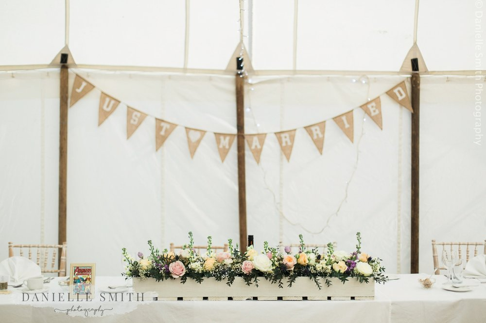 pastel coloured wedding flowers on top table