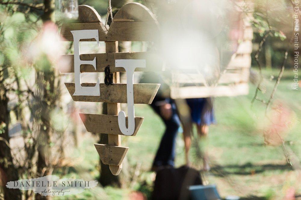 initials on wooden heart at garden wedding
