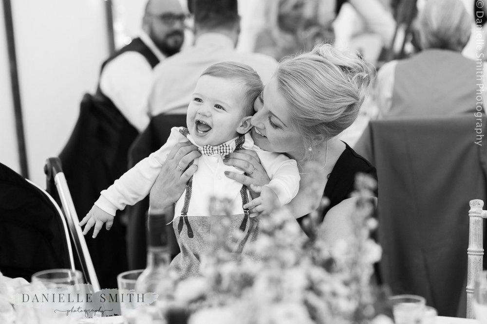 mum with baby boy at - ingatestone hall wedding