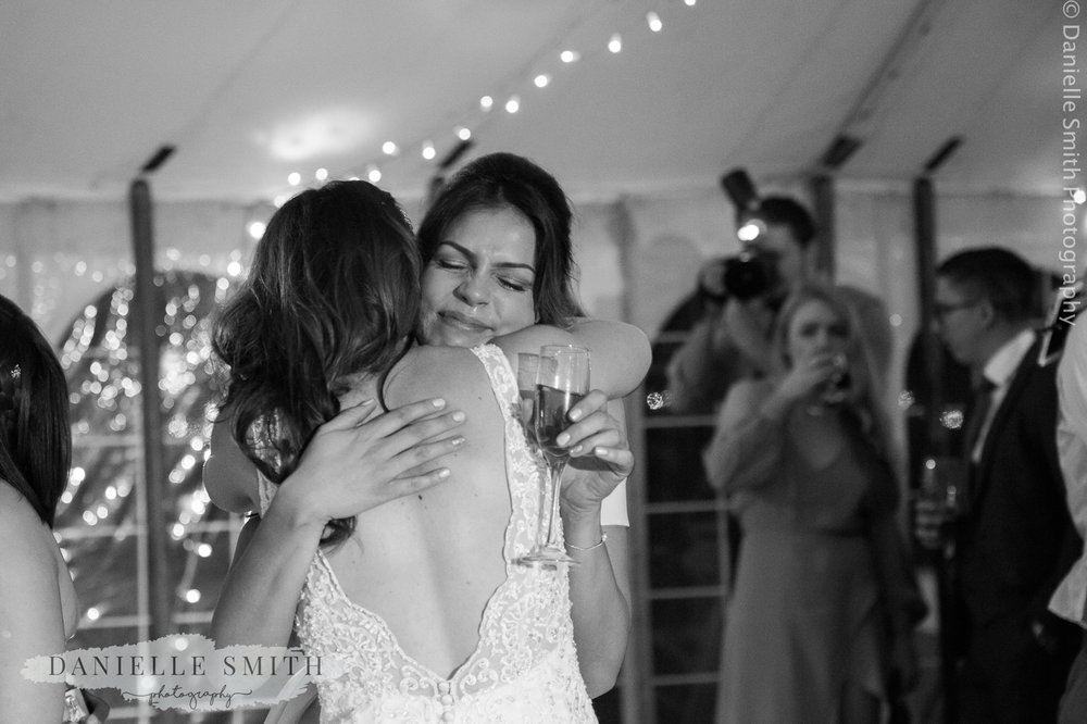bride hugging her best friend crying