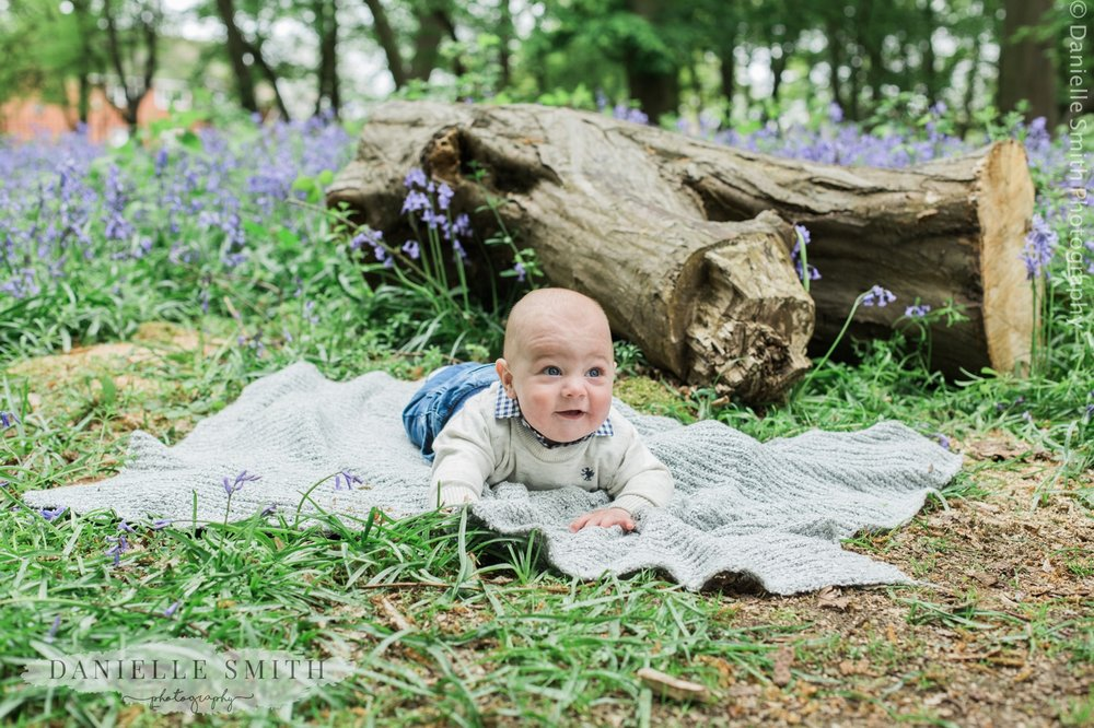 baby boy in bluebell woods