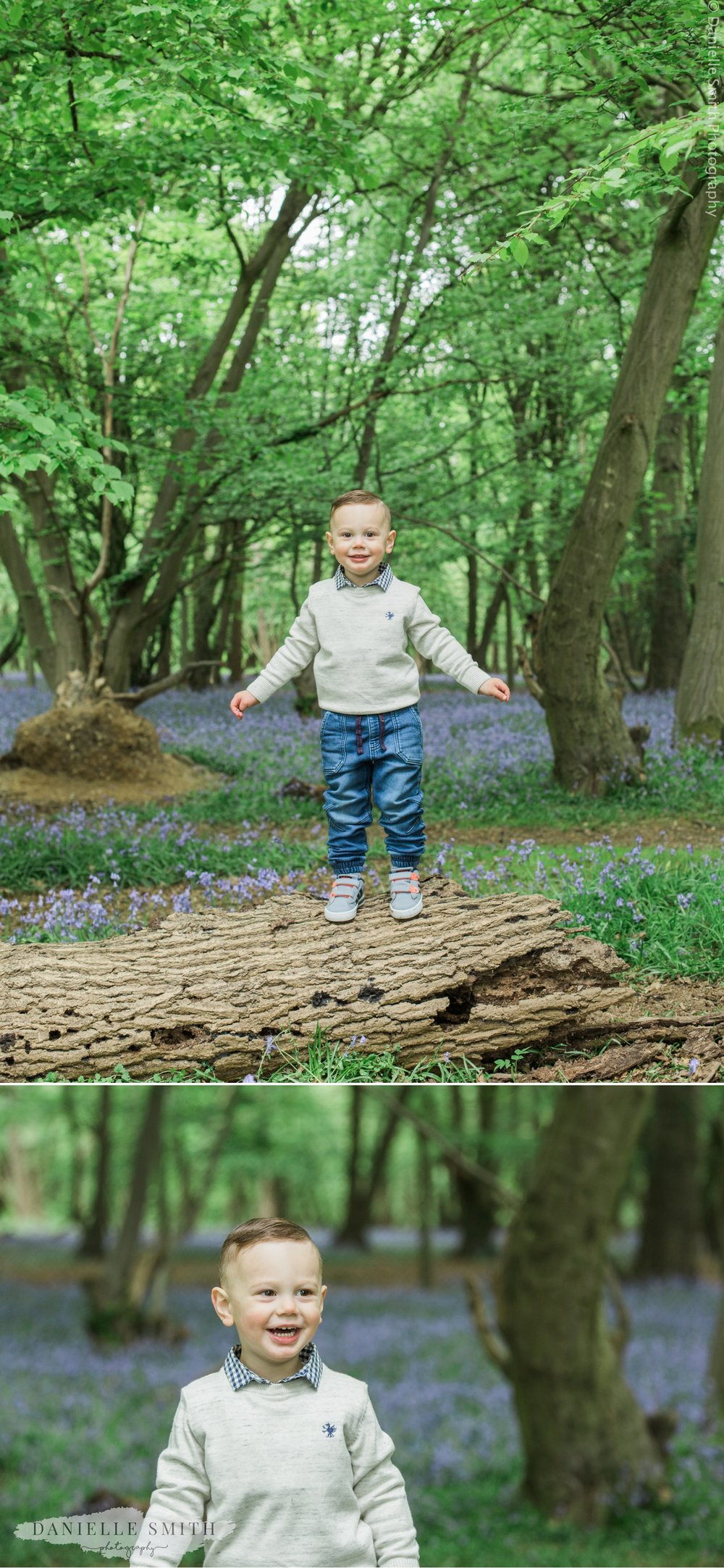 little boy smiling in bluebell woods photography