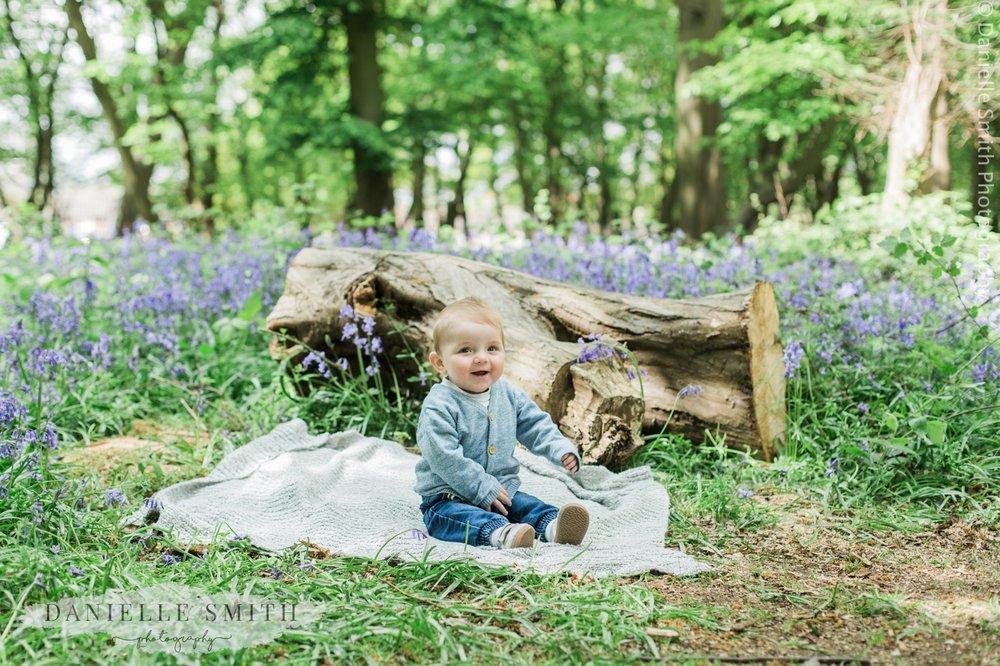 little boy sitting in bluebell woods - bluebell family photo shoot