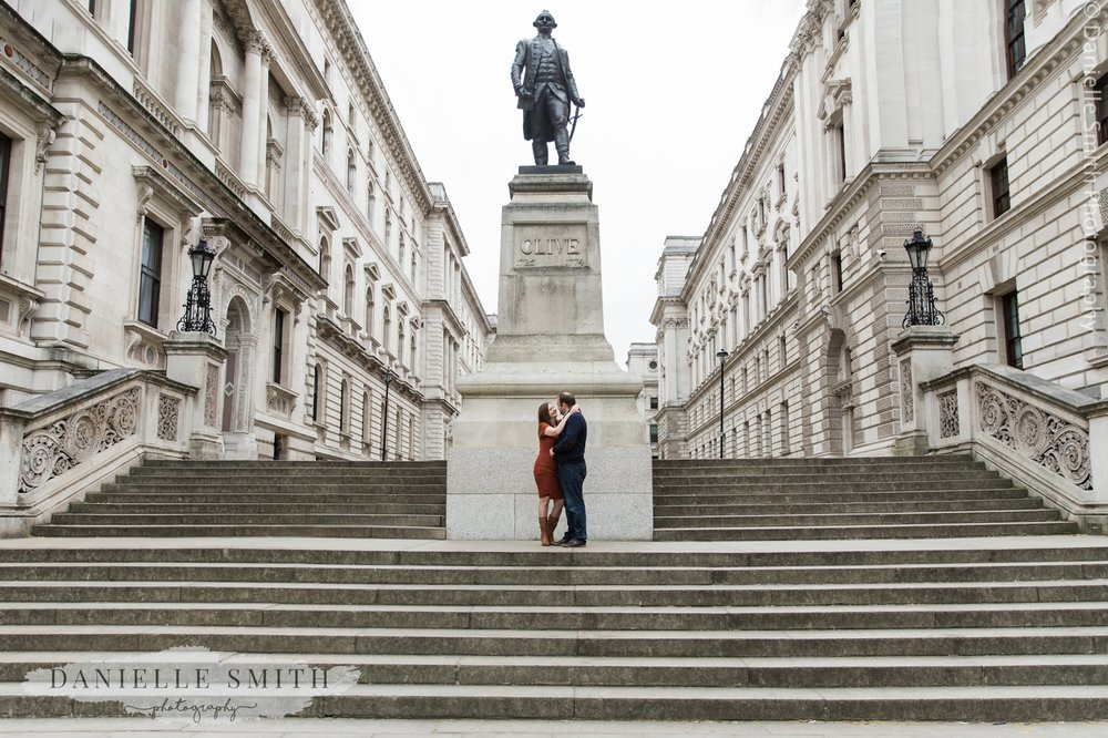couple standing by statue in westminster