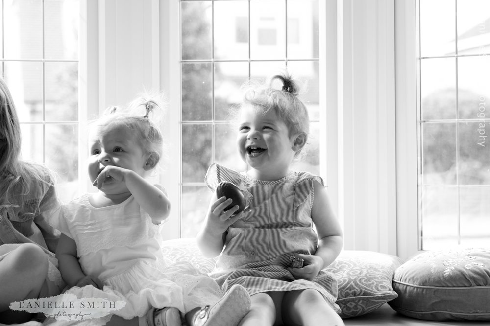 little girl laughing with easter egg in hand