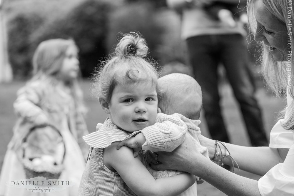 little girl cuddling her baby cousin