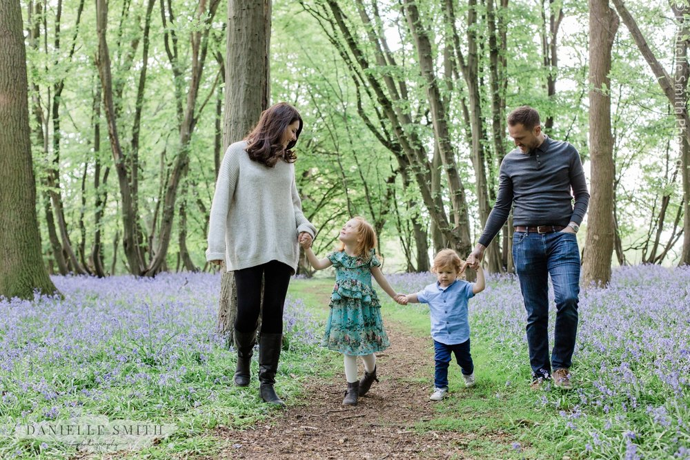 family walking through forest - bluebells family photos