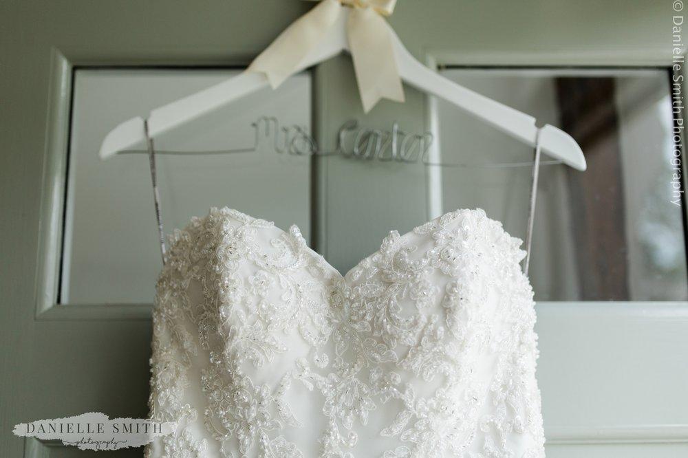 wedding dress hanging on front door