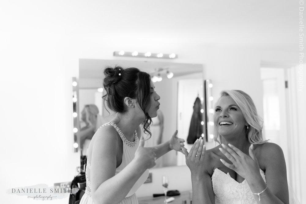bride crying and bridesmaid blowing eyes