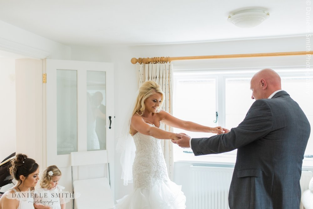 dad seeing his daughter in her wedding dress