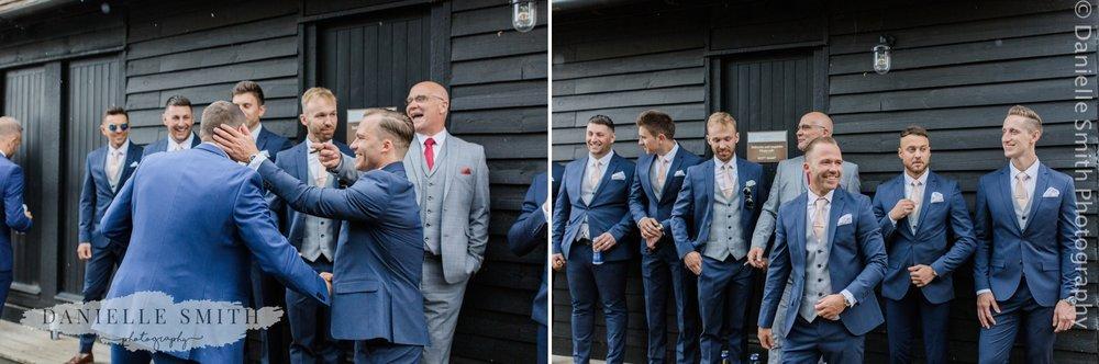groomsmen in rain at blake hall wedding