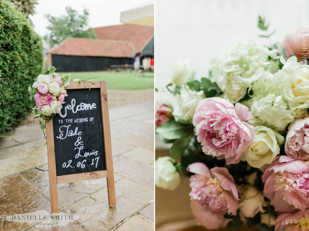 welcome sign at summer wedding