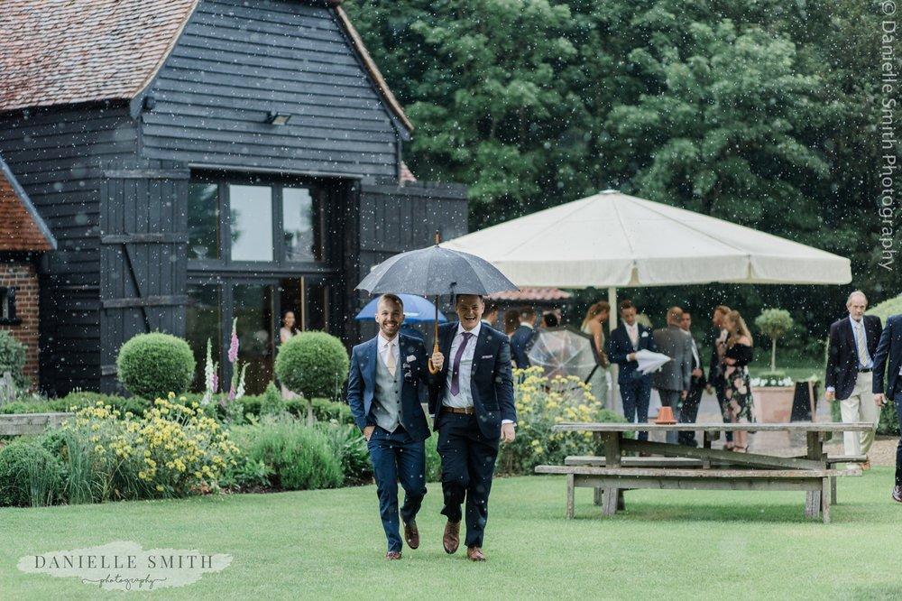 wedding guests with umbrella
