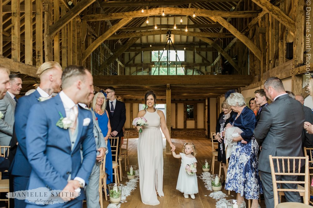 bridesmaid and flower girl walking down aisle - blake hall wedding
