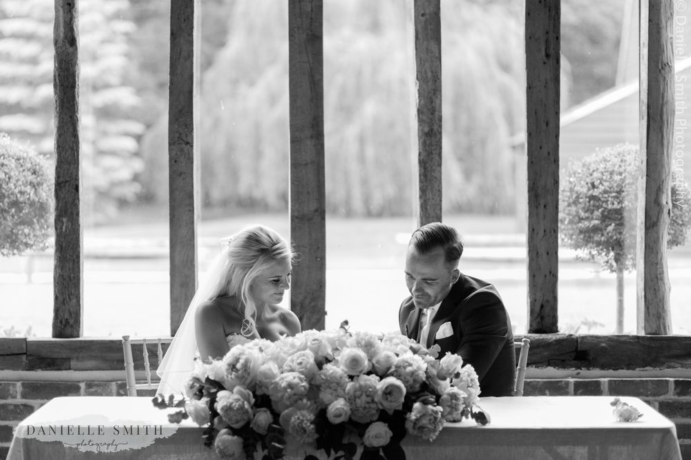 bride and groom signing the register at blake hall ongar