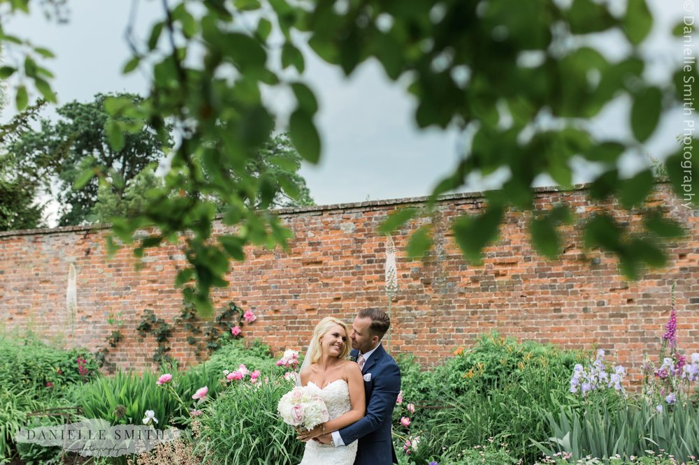couple in gardens - blake hall wedding photography