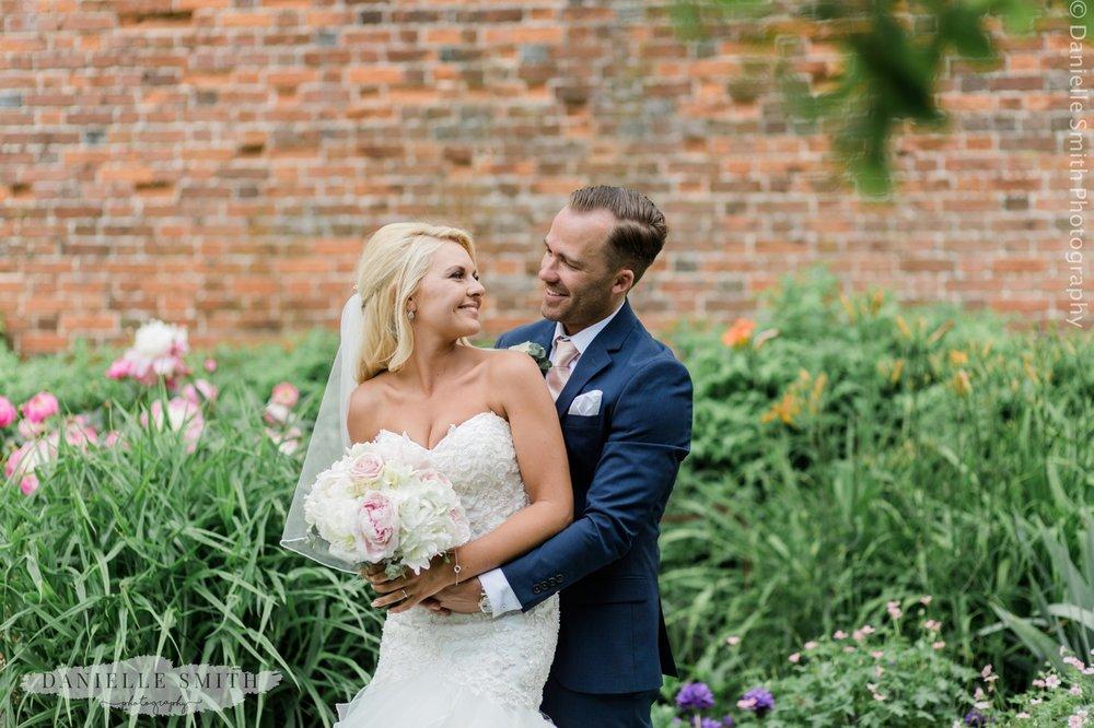 bride and groom smiling - blake hall gardens