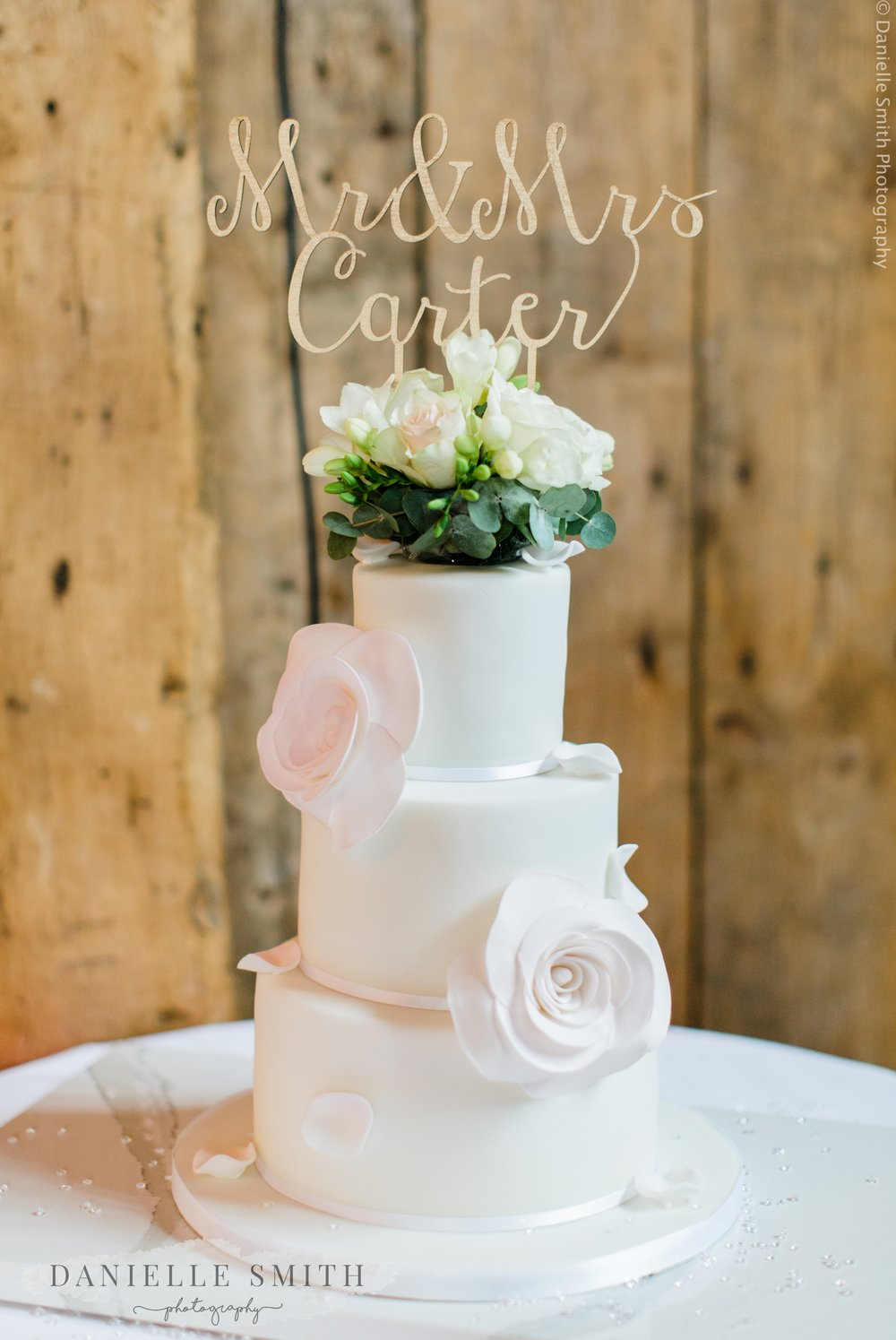 3 tier white wedding cake with flowers