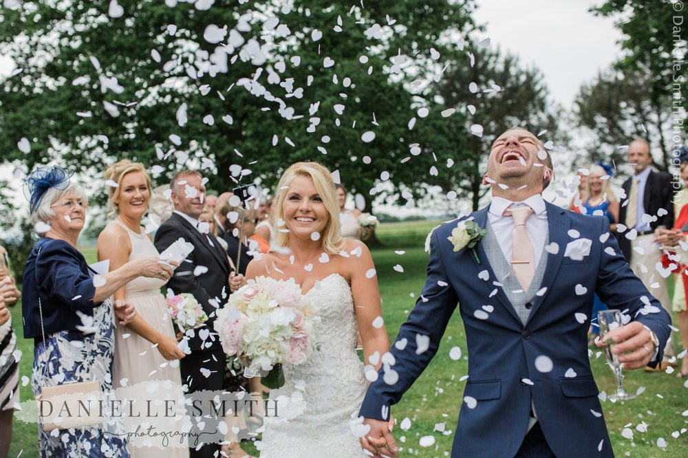 groom laughing head off during confetti