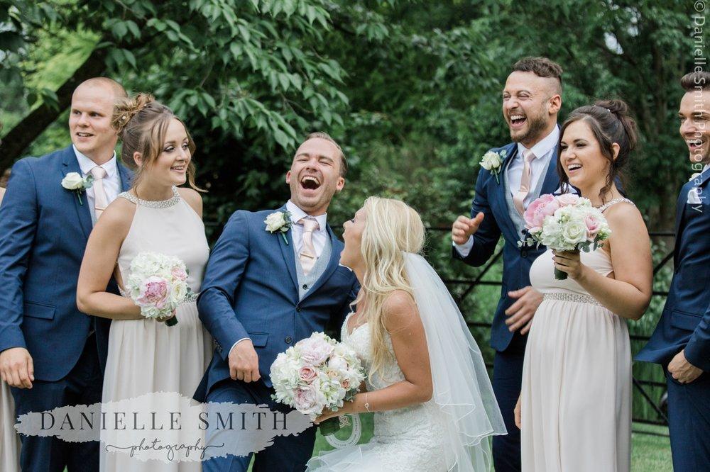 bridal party laughing at blake hall