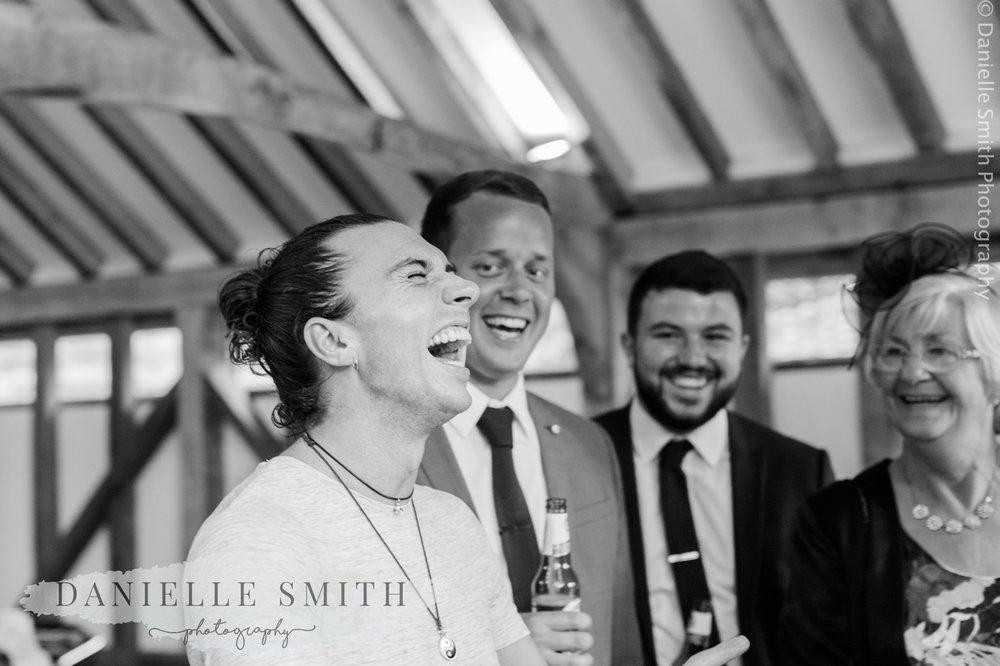 men laughing at wedding