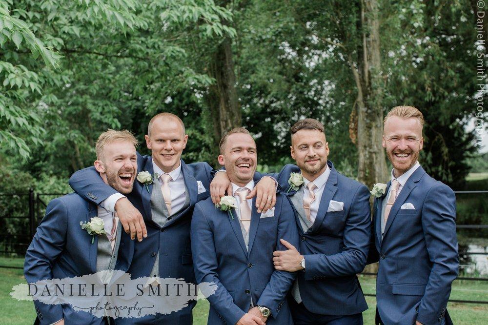 groomsmen laughing - blake hall wedding photography
