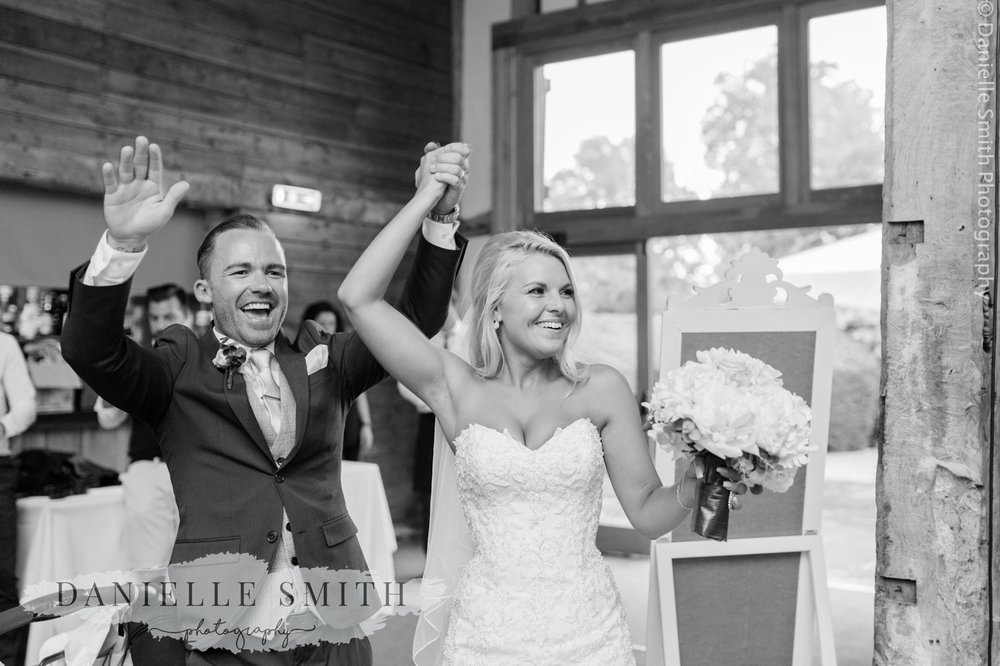 bride and groom cheering when they walk in