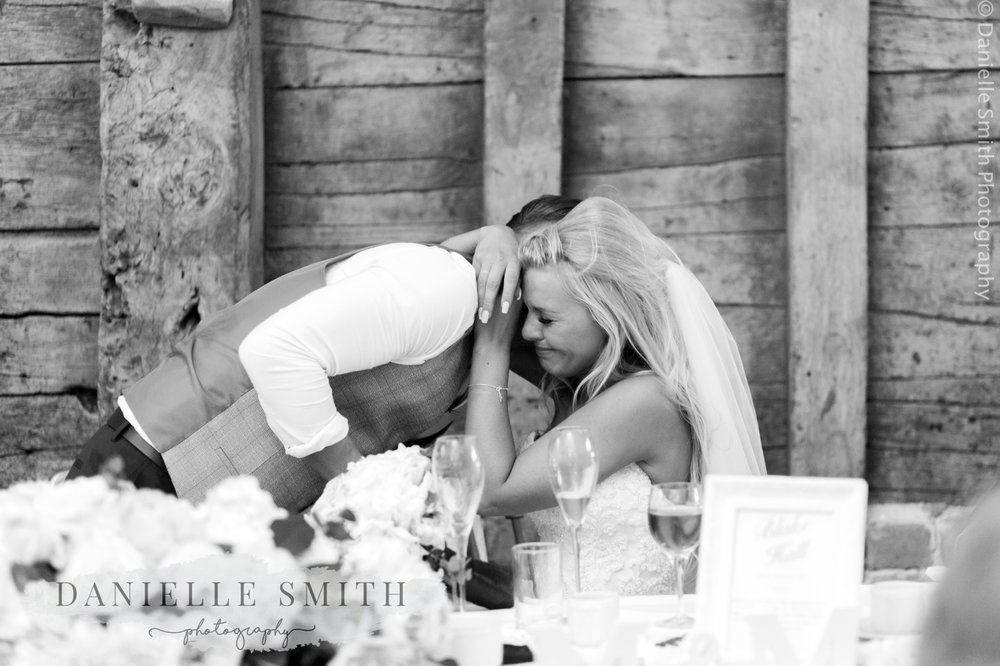 bride crying and hugging groom at blake hall